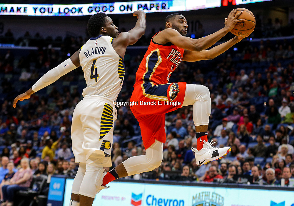 Mar 21, 2018; New Orleans, LA, USA; New Orleans Pelicans guard Ian Clark (2) shoot past Indiana Pacers guard Victor Oladipo (4) during the second half at the Smoothie King Center. The Pelicans defeated the Pacers 96-92. Mandatory Credit: Derick E. Hingle-USA TODAY Sports