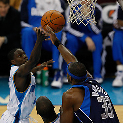 Mar 22, 2010; New Orleans, LA, USA; New Orleans Hornets guard Darren Collison (2) and Dallas Mavericks center Brendan Haywood (33) jump for a rebound during the first half at the New Orleans Arena. Mandatory Credit: Derick E. Hingle-US PRESSWIRE