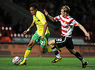 Doncaster - Tuesday September 14th, 2010:  Norwich City's Oli Johnson and Doncaster Rovers's Dean Shiels in action during the NPower Championship match at Keepmoat Stadium, Doncaster. (Pic by Dave Howarth/Focus Images)