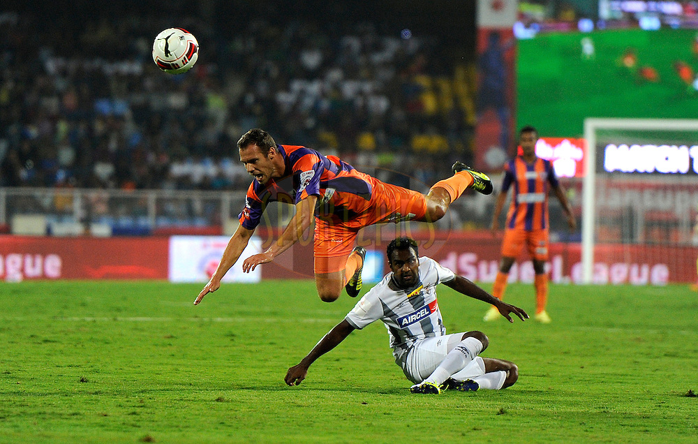 Krisztian Vadocz of Pune City and Rakesh Masih of Atletico de Kolkata in action during match 44 of the Hero Indian Super League between FC Pune City and Atletico de Kolkata FC held at the Shree Shiv Chhatrapati Sports Complex Stadium, Pune, India on the 29th November 2014.<br /> <br /> Photo by:  Pal Pillai/ ISL/ SPORTZPICS