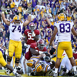 November 6, 2010; Baton Rouge, LA, USA; LSU Tigers running back Stevan Ridley (34) pushes through the pile for a touchdown during the fourth quarter against the Alabama Crimson Tide at Tiger Stadium. LSU defeated Alabama 24-21.  Mandatory Credit: Derick E. Hingle