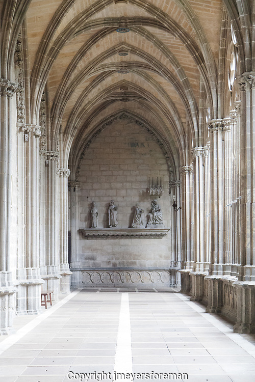 "The cloister is considered on of the best exhibits of French Gothic style in Spain and one of the finest cloisters in Europe. We can see the 14 c scupltures titled ""We three Kings"" at the end of a long line of beautiful arches and columns."