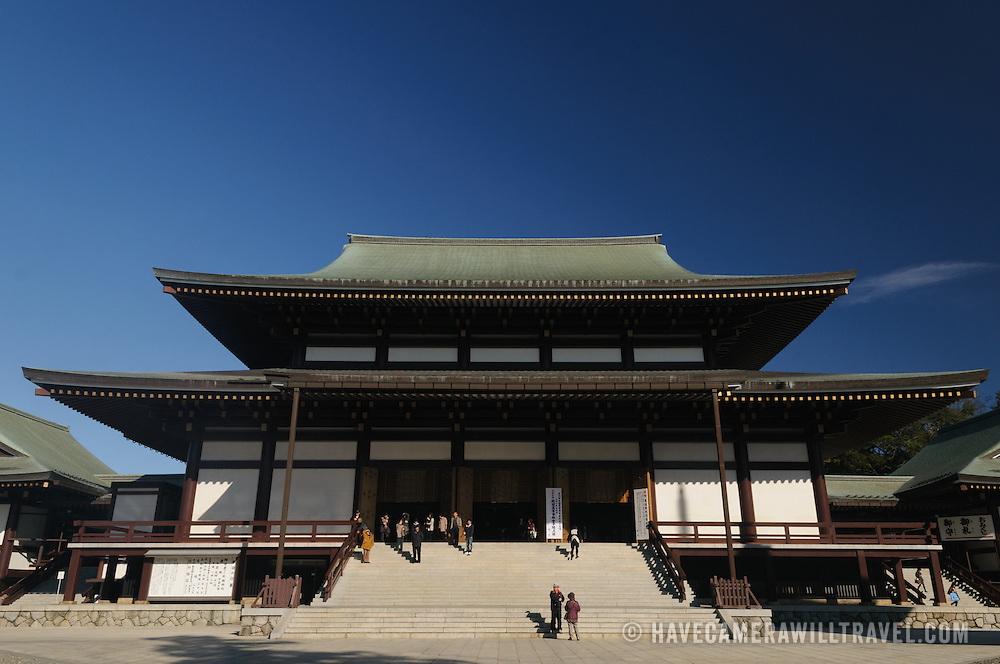 The Great Main Hall at Shinshoji. The Narita-san temple, also known as Shinsho-Ji (New Victory Temple), is Shingon Buddhist temple complex, was first established 940 in the Japanese city of Narita, east of Tokyo.