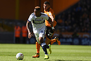Middlesbrough striker Britt Assombalonga (9) breaks away from Wolverhampton Wanderers midfielder Romain Saiss (27) 0-0 during the EFL Sky Bet Championship match between Wolverhampton Wanderers and Middlesbrough at Molineux, Wolverhampton, England on 5 August 2017. Photo by Alan Franklin.