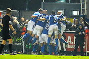 Mikael Mandron (19) of Eastleigh is mobbed by his team mates during the celebrations of scoring a goal to give a 1-0 lead to the home team during the The FA Cup match between Eastleigh and Swindon Town at Arena Stadium, Eastleigh, United Kingdom on 4 November 2016. Photo by Graham Hunt.