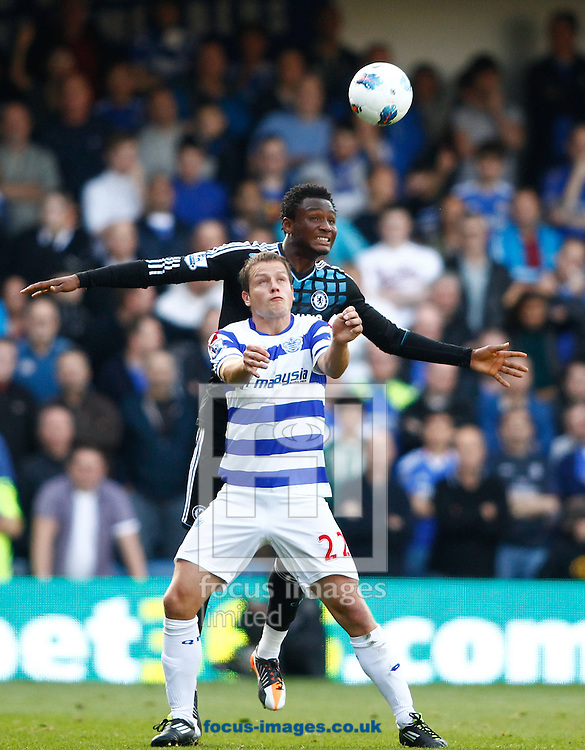 Picture by Andrew Tobin/Focus Images Ltd. 07710 761829. 23/10/11. Heidar Helguson (22) of QPR \cb John Obi Mikel (12) of Chelsea during the Barclays Premier League match between QPR and Chelsea at Loftus Road, London.
