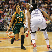 Tanisha Wright, Seattle Storm, drives to the basket defended by Alex Bentley, Connecticut Sun,  during the Connecticut Sun Vs Seattle Storm WNBA regular season game at Mohegan Sun Arena, Uncasville, Connecticut, USA. 23rd May 2014. Photo Tim Clayton