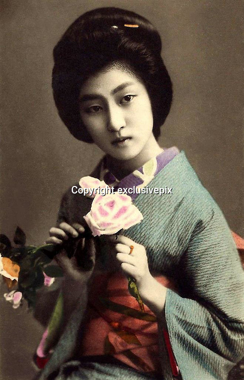 Memories of a geisha: Stunning images reveal the delicate beauty of the woman who enchanted Tokyo 100 years ago<br /> <br /> <br /> The beauty of one of Tokyo's most popular geisha has been preserved in a series of stunning postcards taken more than a century ago. <br /> The collection of images shows Hawaryu, who worked in the Japanese capital at the beginning of the 20th century, posing in a variety of elaborate kimono with her hair pinned in traditional style. <br /> Her porcelain skin and doll-like features have captured the imagination of internet users who have shared the pictures hundreds of times since they were posted. <br /> They were unearthed by an American photographer who lives and works in Japan and posted on his&nbsp;Flickr account under the name Okinawa Soba. <br /> He said the selection were taken in 1910, only a few years before the number of geisha working in the country reached its peak.<br /> It is not known how old Hawaryu is in the series of pictures but her hairstyle suggests she was an apprentice geisha - or maiko - and therefore was probably under 20 years old. <br /> Geisha as a profession emerged in the 18th century and rather than courtesans, women would entertain act as hostesses and entertain male guests with their demure conversation and graceful dance and music skills. <br /> Not much is known about Harwaryu other than the pictures she left behind. <br /> If her marriage was delayed or did not take place then she may have continued working as a geisha for years. <br /> More is known about the photographers, whose initials were left on the images. <br /> One photographer is believed to be Shisui Naruse and the other is thought to be Yoto Tsukamoto. <br /> Okinawa Soba said of the Naruse: 'He obviously considered his portraits to be artistic works, and proudly put his intertwined S N monogram right on the negative.'<br /> The images were printed on mass using the collotype process and the coloured detail would have been hand-painted afterwards. <br /> In some of the images crosshatching can also be seen on the hairline and eyebrows,