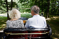 "9 July, 2008. Doylestow, PA. Jim Grundy, 54, drives his 1909 Pierce Arrow antique car. Next to him is Patricia Grundy, who sat in the back seat of this car at the age of 16, when her parents drove from Philadelphia to Detroit to participate at the Glidden Tour.  Jim Grundy is the chief executor of Grundy Worldwide, an insurance company for collectible cars. His father Jim Sr. Jr. started the business in 1947 and wrote the first antique car insurance policy in 1949. Jim Grundy has been in the business for 28 years and assumed major interest and the presidency 19 years ago. ""I own the best pre World War I cars ever manufactured"", Mr. Grundy says. <br /> <br /> ©2008 Gianni Cipriano for The Wall Street Journal<br /> cell. +1 646 465 2168 (USA)<br /> cell. +1 328 567 7923 (Italy)<br /> gianni@giannicipriano.com<br /> www.giannicipriano.com"