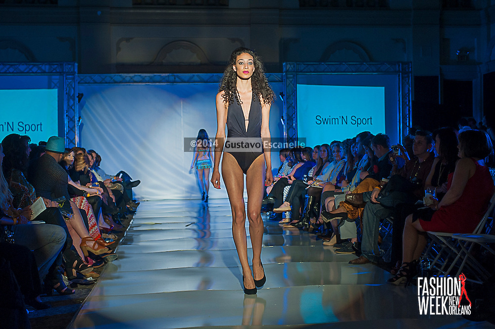 FASHION WEEK NEW ORLEANS: Swim 'N Sport show case there design on the runway at the Board of Trade, Fashion Week New Orleans on Wednesday March 19. 2014. #FWNOLA, #FashionWeekNOLA, #Design #FashionWeekNewOrleans, #NOLA, #Fashion #BoardofTrade, #GustavoEscanelle, #TraceeDundas , #romeyRoe, #DominiqueWhite . View more photos at <br /> http://Gustavo.photoshelter.com.