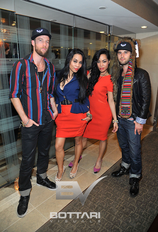 LAS VEGAS, NV - FEBRUARY 19:  (L-R) Spirit Hoods co-owner Marley Marotta, designers To-Tam Sachika, To-Nya Sachika and Spirit Hoods co-owner Alexander Mendeluk attend the FlauSachika Groups exclusive magic suite party at Aria Resort & Casino at CityCenter on February 19, 2013 in Las Vegas, Nevada.  (Photo by Jeff Bottari/WireImage)