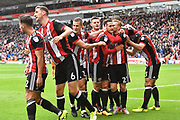 Sheffield United celebrate goal scored by Sheffield United striker Billy Sharp (10) to go 2-0  during the EFL Sky Bet Championship match between Sheffield Utd and Reading at Bramall Lane, Sheffield, England on 21 October 2017. Photo by Ian Lyall.