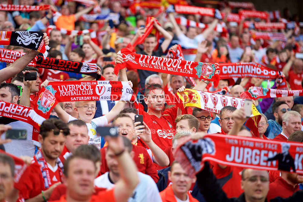 """DUBLIN, REPUBLIC OF IRELAND - Saturday, August 5, 2017: Liverpool supporters holding scarves sing """"You'll Never Walk Alone"""" before a preseason friendly match between Athletic Club Bilbao and Liverpool at the Aviva Stadium. (Pic by David Rawcliffe/Propaganda)"""