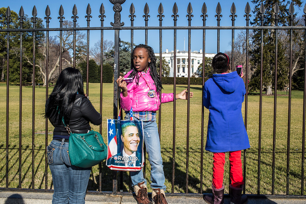 Theresa Jones, Kiyanta Colowney, 11, and Reshae Williams, 10, from left, visit the White House on Sunday, January 20, 2013 in Washington, DC.