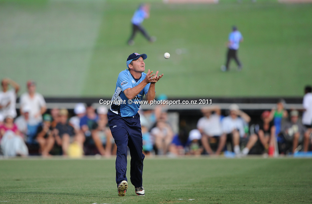 Auckland fielder Bruce Martin takes a catch during the HRV Twenty20 Cricket match between the Auckland Aces and Otago Volts at Colin Maiden Oval in Auckland, New Zealand on Friday 6 January 2012. Photo: Andrew Cornaga/Photosport.co.nz