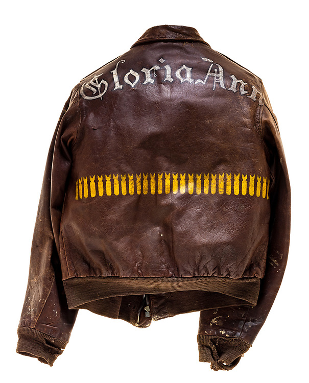 "This type A-2 flight jacket belonged to Thomas F. Murphy, a tail gunner attached to the 569th squadron of the 390th Bomb Group. On the back of the jacket is the name of Murphy's aircraft the ""Gloria Ann"". There are 27 bombs painted on the back of the jacket signifying the amount of successful missions Murphy flew. On the 27th mission, a raid on Berlin, Germany on March 6, 1944, the ""Gloria Ann"" suffered severe damage but was able to fly back to base. Due to the damage suffered on this mission ""Gloria Ann"" was salvaged after 27 completed missions."
