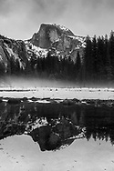 black and white, Half Dome in winter with reflections in Yosemite National Park, California