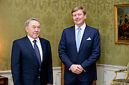 DEN HAAG - Koning Willem-Alexander ontvangt president Nursultan Nazarbayez van Kazachstan op paleis Huis ten Bosch. Aanleiding voor het bezoek is de nucleaire veiligheidstop NSS in Den Haag. Dutch King Willem-Alexander (R) receives Kazakh President Nursultan Nazarbayez at Huis ten Bosch Palace in The Hague, The Netherlands, 23 March 2014, ahead of the Nuclear Security Summit (NSS) in The Hague from 24 to 25 March. COPYRIGHT ROBIN UTRECHT