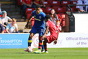 AFC Wimbledon striker Lyle Taylor (33) and Walsall FC defender Rico Henry (3) tussle during the EFL Sky Bet League 1 match between Walsall and AFC Wimbledon at the Banks's Stadium, Walsall, England on 6 August 2016. Photo by Stuart Butcher.