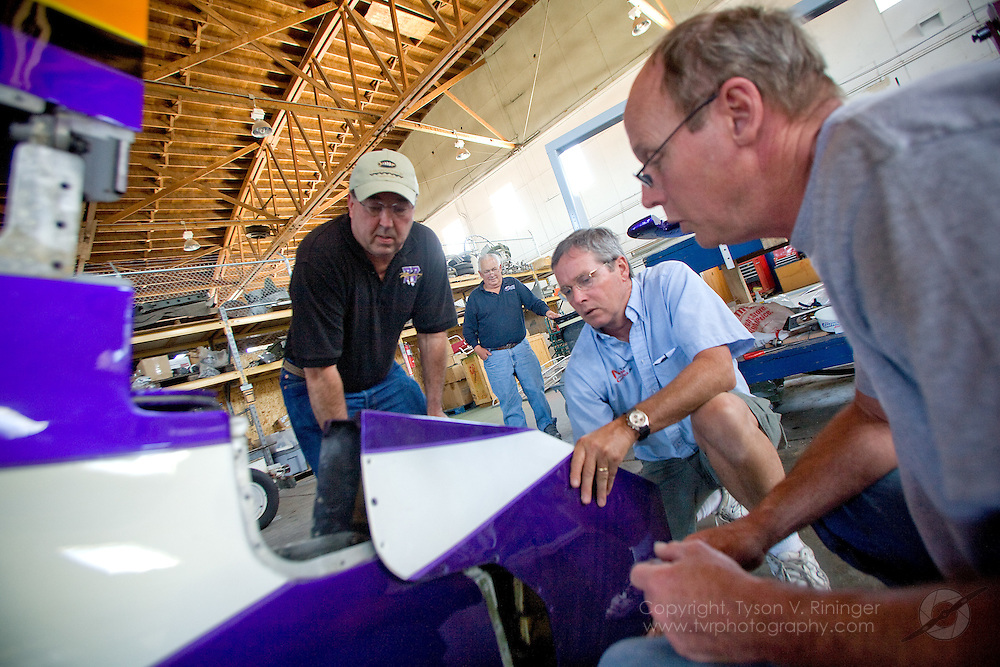 Rare Bear Preparation 2009. (L-R) Crew Chief Dave Cornell, Fabrication Specialist John Parker, Team Lead Alby Redick and Mechanic Keith Geary work on fitting the tail fairing to the famed F8f Bearcat.