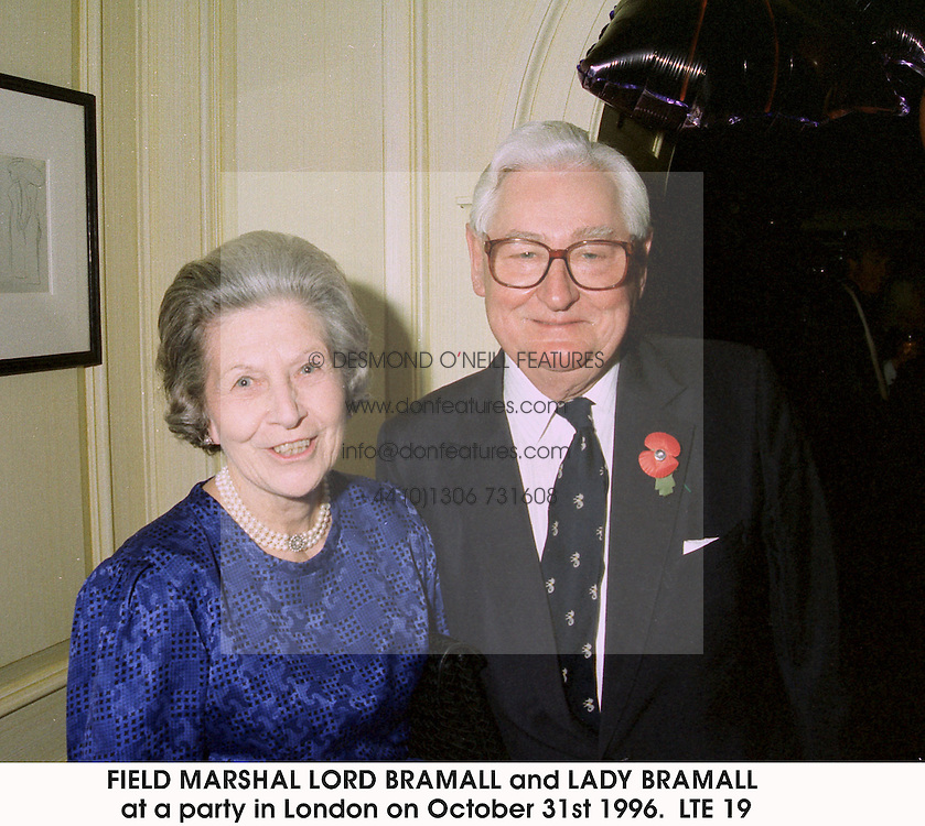 FIELD MARSHAL LORD BRAMALL and LADY BRAMALL at a party in London on October 31st 1996. LTE 19