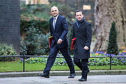 © Licensed to London News Pictures. 10/01/2017. London, UK. Secretary of State for Communities and Local Government Sajid Javid (L) and Secretary of State for Wales Alun Cairns (R) arrive on Downing Street ahead of the weekly Cabinet meeting. Photo credit: Rob Pinney/LNP