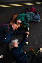 © Licensed to London News Pictures. 07/10/2019. London, UK. Extinction Rebellion (XR) activists bolting and gluing themselves to street furniture and makeshift obstacles and each other. Photo credit: Guilhem Baker/LNP