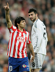 MADRID, SPAIN - Sunday, March 28, 2010: Club Atletico de Madrid's Sergio Aguero and Real Madrid Club de Futbol's Raul Albiol during the La Liga Primera Division Madrid Derby match at the Estadio Santiago Bernabeu. (Pic by Hoch Zwei/Sprimont Press/Propaganda)