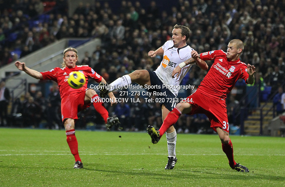 1/11/2010 Bolton Wanderers v Liverpool, Barclays Premier League.<br /> Bolton's kevin Davies under pressure from Martin Skirtel and Christian Poulsen<br /> Photo: Mark Robinson.
