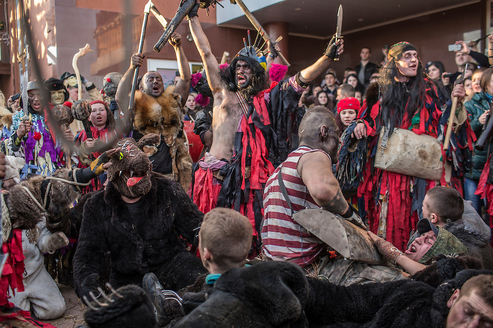 KRASNOILSK, UKRAINE - JANUARY 14: Villagers celebrate the winter festival of Malanka on January 14, 2015 in Krasnoilsk, Ukraine. The holiday, which involves dressing in elaborate costumes and going from house to house as a group singing traditional songs, is celebrated on New Year's Day of the Orthodox calendar, a week after Orthodox Christmas.
