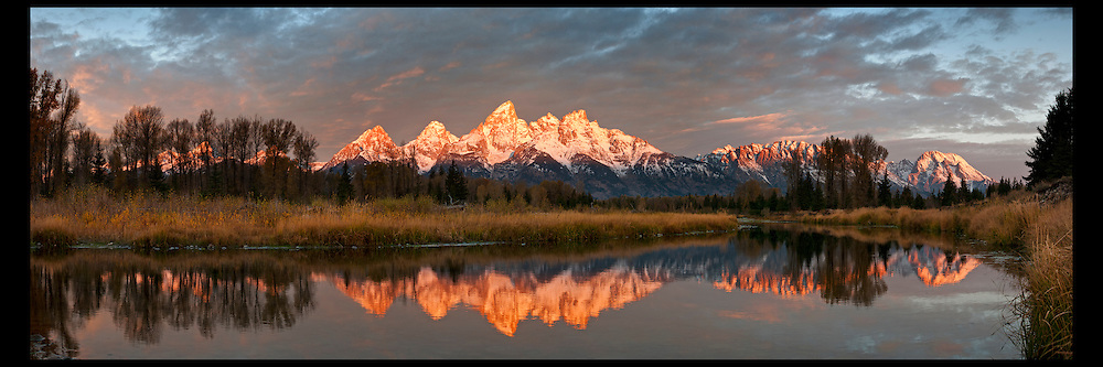 A band of morning light hitting the Grand Teton Range at Schwabacher Landing in Grand Teton National Park.