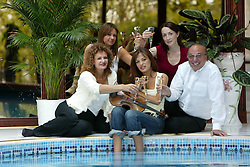 16 year old Nicola Benedetti wins the BBC Young Musician of the Year in 2004. Pictured with her sister Stephannie, mum Francesca, dad Gio and pianist Alison Rhind (back), at home in West Kilbride, 3/05/2004..Pic ©2010 Michael Schofield. All Rights Reserved..