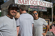 Men from Baby Got Back Ribs show off their T-shirts. The business was a finalist for Best of Market Vendors, awarded to a vendor with a brick and mortar presence.