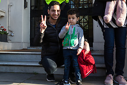 London, UK. 14th February, 2019. Sayed Ahmed Alwadaei kneels outside the Bahrain Embassy with activists from the Bahrain Institute for Rights and Democracy (BIRD) and Campaign Against the Arms Trade (CAAT) to mark eight years since the Day of Rage in Bahrain, a movement for democracy and social justice which was crushed by the Bahraini regime with support from the military of Saudi Arabia. Speakers called for the release of political prisoners held in Bahrain and for the UK to stop licensing arms to Bahrain (over £100 million in licences have been granted since the uprising began in February 2011). Alwadaei was granted asylum in the UK in 2012 after being given a six-month sentence by the Bahrain government for his involvement in Arab Spring protests. Bahrain was recently found guilty by a UN body of arbitrarily detaining three of his relatives after he protested in London against a 2017 visit by the King of Bahrain Hamad bin Isa Al Khalifa.