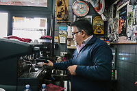 TARANTO, ITALY - 22 FEBRUARY 2018: Ignazio D'Andria, owner of the Mini Bar, prepares a coffee in his bar in Tamburi, the working-class district adjacent the ILVA steel mill in Taranto, Italy, on February 22nd 2018.<br /> <br /> Taranto, a  formerly lovely town on the Ionian Sea has for the last several decades been dominated by the ILVA steel mill, the largest steel plant in Europe. It was built by the government in the 1960s as a means of delivering jobs to the economically depressed south, but has been implicated for a cancer as dioxin and mercury have seeped into local groundwater, tainting the food supply, while poisoning the bay and its once-lucrative mussels.