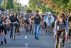 Participants march along a street during a June 3, 2020, Black Lives Matter protest in Eugene, Oregon. Participants were protesting the murder of George Floyd and other African-Americans by police.