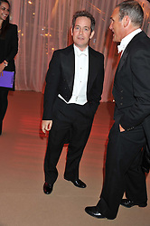 Left to right, TOM HOLLANDER and AA GILL at the Raisa Gorbachev Foundation Gala held at the Stud House, Hampton Court, Surrey on 22nd September 22 2011
