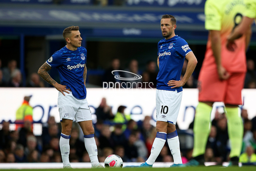 Everton defender Lucas Digne (12) and Everton midfielder Gylfi Sigurdsson (10) line up the free kick during the Premier League match between Everton and Manchester City at Goodison Park, Liverpool, England on 28 September 2019.