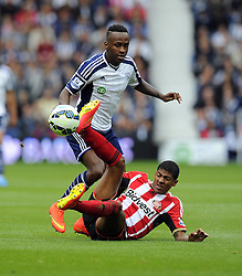 West Bromwich Albion's Saido Berahino battles for the ball with Sunderland's Patrick Van Aanholt - Photo mandatory by-line: Joe Meredith/JMP - Mobile: 07966 386802 16/08/2014 - SPORT - FOOTBALL - West Bromwich - The Hawthorns - West Bromwich Albion v Sunderland - Barclays Premier League