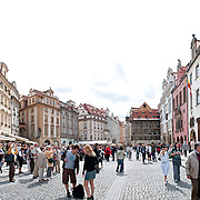 Panorama of tourists in front of the Astronomical Clock in Prague's Old Town Square