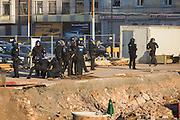 Frankfurt | Germany | 10.09.2015: Bei einer von der TGB (Bund t&uuml;rkischer Jugendlicher) angemeldeten Demonstration mit ca. 500 Teilnehmern kommt es zu Auseinandersetzung mit kurdischen Gegendemonstranten, die u.a. mehrere Stunden die Demoroute an der Paulskirche blockieren.<br /> <br /> hier: Polizisten verhindern am Hauptbahnhof ein Durchbrechen der Kurden zur t&uuml;rkischen Demo. Auf einer Baustelle an der S&uuml;dseite des HBF kommt es zu Ausschreitungen und Festnahmen.<br /> <br /> 20150910<br /> Sascha Rheker<br /> <br /> [Inhaltsveraendernde Manipulation des Fotos nur nach ausdruecklicher Genehmigung des Fotografen. Vereinbarungen ueber Abtretung von Persoenlichkeitsrechten/Model Release der abgebildeten Person/Personen liegt/liegen nicht vor.] [No Model Release | No Property Release]