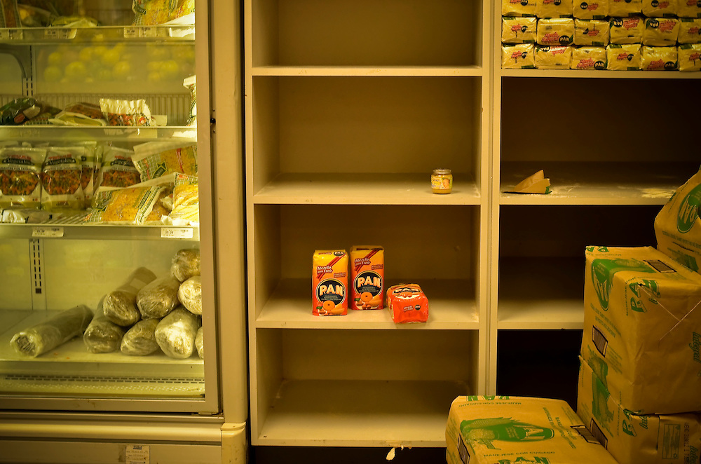 A sparse shelf reserved to stock Harina Pan, a popular brand of flour for making arepas, Venezuelas staple corn cake, at a grocery store in downtown Caracas, Venezuela. Shortages of staples like milk, meat and toilet paper are a chronic problem here, turning shopping into a hit or miss proposition. In January, according to a scarcity index compiled by the Central Bank of Venezuela, the difficulty of finding a marketbasket of basic goods on store shelves was at its most acute level since 2008.