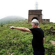 American war veteran Ron Chambers returns to Danang, Vietnam, where he was stationed during the war 40 years ago. Here, Ron obvserves Hai Van Pass, where had run truck convoys during the war.
