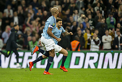 February 24, 2019 - London, England, United Kingdom - Kyle Walker of Manchester City and Vincent Kompany of Manchester City celebrate after winning the penalty shoot out during the Carabao Cup match between Chelsea and Manchester City at Wembley Stadium, London on Sunday 24th February 2019. (Credit Image: © Mi News/NurPhoto via ZUMA Press)