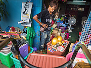 12 NOVEMBER 2015 - BANGKOK, THAILAND:   A man packs the belongings of a Wat Kalayanmit resident on the day the family was being evicted. Fifty-four homes around Wat Kalayanamit, a historic Buddhist temple on the Chao Phraya River in the Thonburi section of Bangkok, are being razed and the residents evicted to make way for new development at the temple. The abbot of the temple said he was evicting the residents, who have lived on the temple grounds for generations, because their homes are unsafe and because he wants to improve the temple grounds. The evictions are a part of a Bangkok trend, especially along the Chao Phraya River and BTS light rail lines. Low income people are being evicted from their long time homes to make way for urban renewal.       PHOTO BY JACK KURTZ