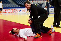 Uros Zorman of Slovenia and physiotherapist Sokol Kadrija during practice session of Slovenia national team 1 day before handball match against Macedonia for 5th place at 10th EHF European Handball Championship Serbia 2012, on January 26, 2012 in Beogradska Arena, Belgrade, Serbia.  (Photo By Vid Ponikvar / Sportida.com)
