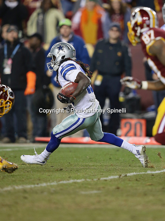 Dallas Cowboys wide receiver and kick returner Lucky Whitehead (13) returns a late fourth quarter kickoff 46 yards to the Cowboys 44 yard line and setting up a game winning drive with less than one minute left on the clock during the 2015 week 13 regular season NFL football game against the Washington Redskins on Monday, Dec. 7, 2015 in Landover, Md. The Cowboys won the game 19-16. (©Paul Anthony Spinelli)