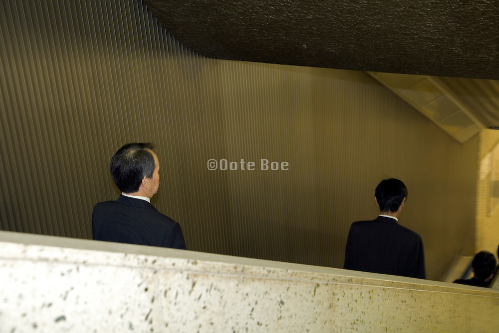 business commuters on an escalator Tokyo Japan