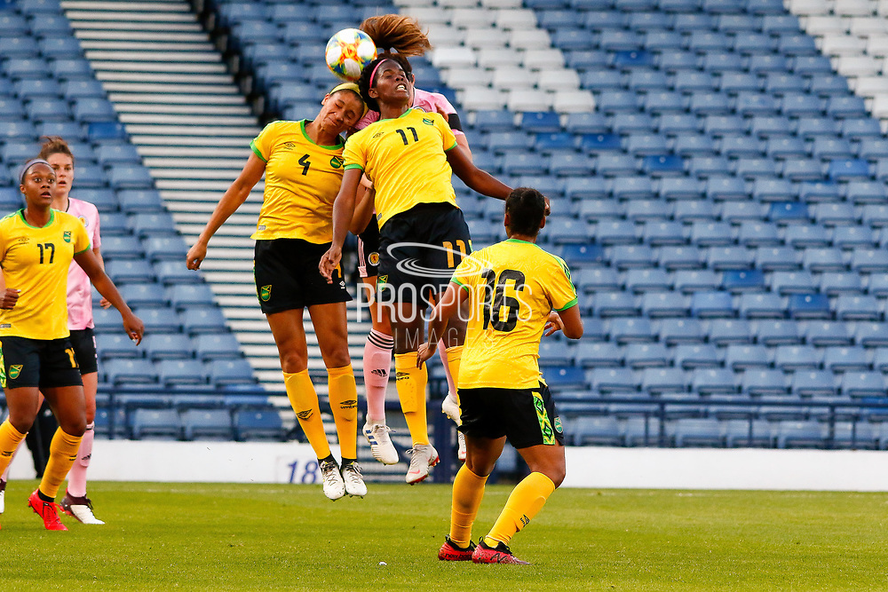 Khadija SHAW (Univ. Tennessee (USA)) & Chantelle SWABY (Univ. Rutgers (USA)) of Jamaica clear the danger  during the International Friendly match between Scotland Women and Jamaica Women at Hampden Park, Glasgow, United Kingdom on 28 May 2019.
