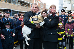 © Licensed to London News Pictures. 23/12/2019. London, UK. London Fire Commissioner (LFC), Dany Cotton hugs a fire dog as she leaves her final day in office. Hundreds of firefighters lined Union Street in London today to provide a Guard of Honour on the final day in office for London Fire Commissioner, Danny Cotton. Photo credit: Vickie Flores/LNP